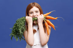 Smiling girl holding bunch of carrot Royalty Free Stock Photography