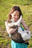 Smiling girl holding cat Royalty Free Stock Image