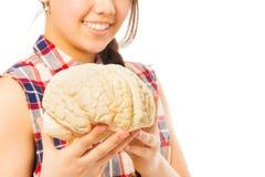 Smiling girl holding cerebrum model in her hands. Isolated on white background stock image