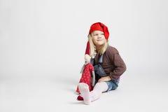 Smiling girl holding Christmas elf doll Stock Images