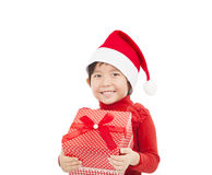 Smiling  girl holding christmas gift Royalty Free Stock Photo