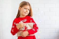 Smiling girl holding Christmas gift stock photo