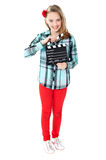 Smiling girl holding clapperboard Stock Photos