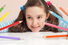 Smiling girl holding color pencils. Beautiful smiling girl holding color pencils Royalty Free Stock Photos