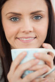 Smiling girl holding a cup of coffee Stock Photo