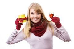 Smiling girl holding cup of tea wrapped scarf and autumnal decoration Royalty Free Stock Photo