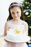 Smiling Girl Holding Delicious Christmas Cake Stock Photo