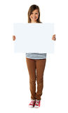 Smiling girl holding empty white board Stock Photography