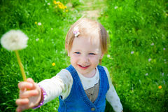 Smiling girl holding a flower Royalty Free Stock Images