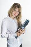 Smiling girl holding folders Stock Photo