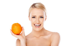 Smiling girl is holding fresh orange Stock Image
