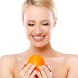 Smiling girl is holding fresh orange Stock Photography