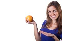 Smiling girl holding fresh orange Royalty Free Stock Photography