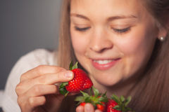 Smiling Girl Holding Fresh Red Strawberries Royalty Free Stock Images
