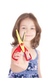 Smiling girl holding fun craft scissors Royalty Free Stock Image