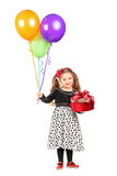 Smiling girl holding a gift and balloons Stock Photos