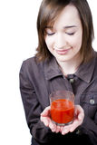 Smiling girl holding the glass of tomato juice Royalty Free Stock Photos
