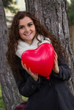Smiling girl holding a heart Stock Images