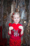 Smiling girl holding heart symbol Stock Photos
