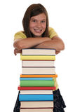 Smiling girl holding her head on books Royalty Free Stock Photo