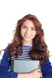 Smiling girl holding laptop Stock Images