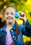 Smiling girl holding little Earth at hand Stock Image