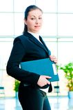 A smiling girl holding a manager office folder Stock Images