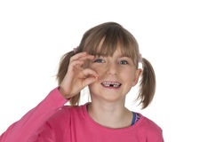 Smiling girl holding missing tooth Stock Photography