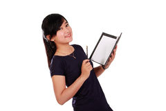 Smiling girl holding notebook isolated Royalty Free Stock Image