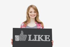 Smiling girl holding panel with thumb up representing social net Stock Photo