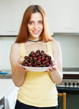 Smiling  girl holding plate with cherries Stock Photo