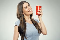 Smiling girl holding red coffee cup Stock Images