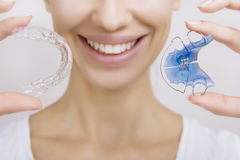 Smiling girl Holding Retainer for Teeth and Tooth Tray. Beautiful Smiling girl Holding Retainer for Teeth (Dental Braces) and Individual Tooth Tray. Orthodontics royalty free stock image