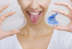 Smiling girl Holding Retainer for Teeth and Tooth Tray. Beautiful Smiling girl Holding Retainer for Teeth (Dental Braces) and Individual Tooth Tray. Orthodontics stock image