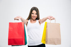 Smiling girl holding shopping bags Royalty Free Stock Images