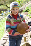 Smiling girl holding soccer ball outdoors.  Stock Images