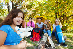 Smiling girl holding sticks with marshmallow Stock Photography