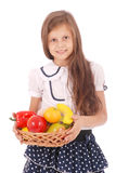 Smiling girl holding straw basket with fruits Stock Photos