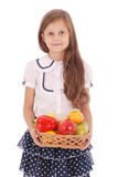 Smiling girl holding straw basket with fruits Royalty Free Stock Photography