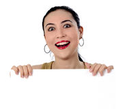 Smiling girl holding white billboard Royalty Free Stock Photos
