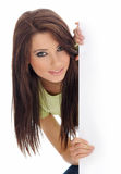 Smiling girl holding white billboard stock image