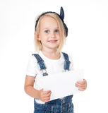 Smiling girl holding a white card,. Banner Royalty Free Stock Image