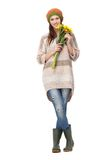 Smiling Girl Holding Yellow Flowers Stock Photography