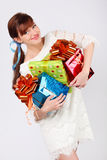 Smiling girl holds boxes with boxes Royalty Free Stock Photo