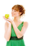 Smiling girl holds green apple Royalty Free Stock Photo