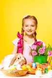Smiling girl holds pail with pink tulips Stock Image