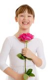 Smiling girl holds a rose, close-up stock photography