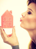 Smiling girl with home symbol. Stock Images