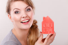 Smiling girl with home symbol. Stock Photography