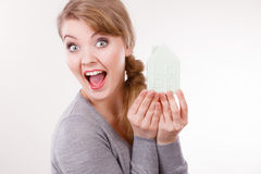 Smiling girl with home symbol. Royalty Free Stock Image